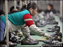 A Chinese worker on a shoe production line