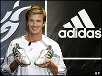David Beckham holding Adidas boots
