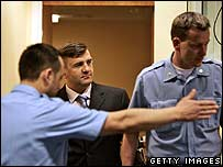 Guards flank Milan Lukic in court (file picture)