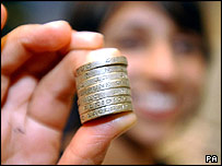 Person holding pound coins