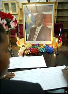 A mourner signs a visitors' book at Mr Garang's former residence in the Kenyan capital, Nairobi