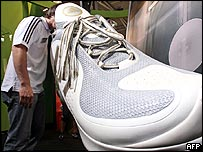 Shopper looks inside a very large Adidas shoe