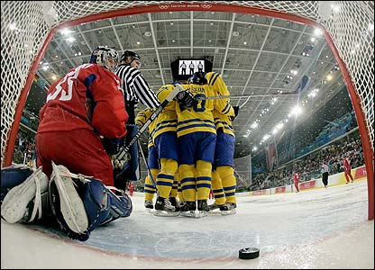 Sweden's Henrik Sedin celebrates with his team-mates after he scored the third goal