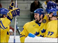 Sweden's Tomas Holmstrom (centre) of Sweden celebrates with Mikael Samuelsson (r) and Henrik Zetterberg (l) after scoring