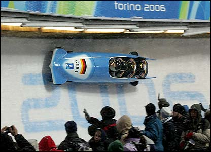 Germany's Andre Lange and his crew power round the bend in the four-man bobsleigh