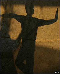 Shadow of a man practising yoga