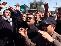 Shia men protest in Mosul on Friday