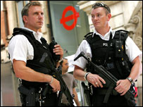 Armed officers patrol London's streets and transport work