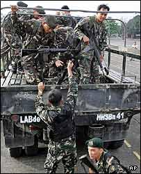 Government troopers were called upon to reinforce their comrades at the Armed Forces of the Philippines Headquarters