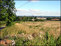 Green belt Guildford, with university development in distance