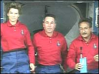 Discovery crew members (left to right) Eileen Collins, Stephen Robinson and Charles Camarda