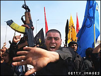 Shia men protest in Baghdad over the bombing of Samarra's al-Askari shrine