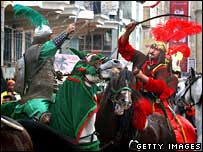 Shia Muslims re-enact the battle near Karbala in which Hussein was killed