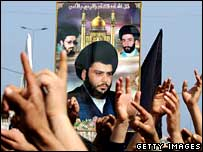 Iraqi Shia wave a poster of Moqtada al-Sadr as they protest