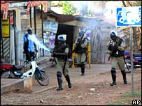 Police fire tear gas to disperse opposition supporters in Kampala