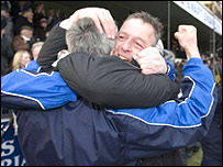Gretna boss Rowan Alexander (right) celebrates the famous win