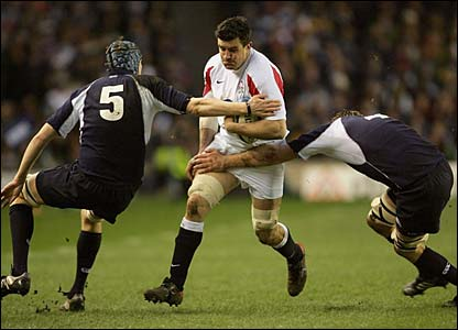 Martin Corry is tackled by Scott McLeod and Alastair Kellock