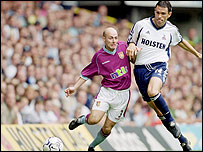 Alan Wright (left) tussles with Gus Poyet