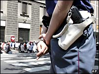 A police officer patrols the street near Milan's Islamic centre