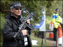 An armed police officer stands guard outside the Gleneagles Hotel
