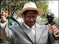 Ugandan President Yoweri Museveni shows his ink-covered finger after casting his vote