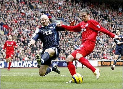 Harry Kewell scores Liverpool's opener under a challenge from Danny Mills
