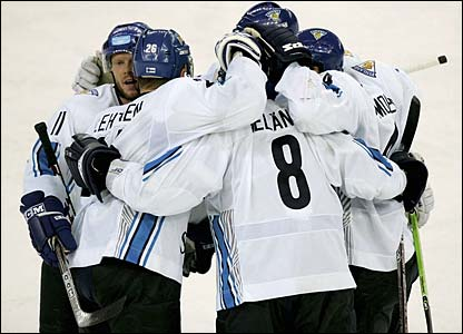 Saku Koivu is mobbed by his team-mates after scoring