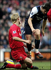 Liverpool defender Sami Hyypia (left) feels the full force of Joey Barton's late tackle