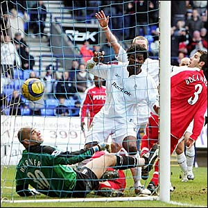 Fulham keeper Tony Warner (left) cannot stop Bolton's leveller