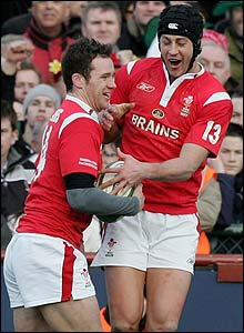 Mark Jones celebrates with Welsh team-mate Hal Luscombe