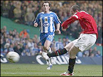 Wayne Rooney slots home Man Utd's opening goal