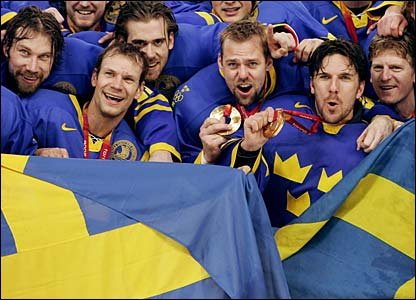 The Sweden team celebrate winning gold