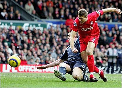 Manchester City's Richard Dunne (left) tackles Steven Gerrard
