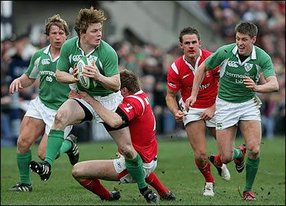 Ireland's captain Brian O'Driscoll breaks away from the Welsh defence