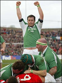 Marcus Horan celebrates an Ireland try before going off injured