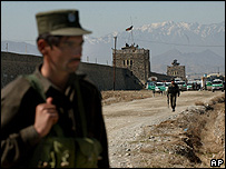 Afghan police officer stands in front of the Pulechakhri prison in Kabul, Afghanistan