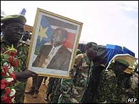 John Garang's body being carried