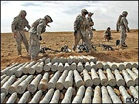 US soldiers uncover a weapons cache in Iraq