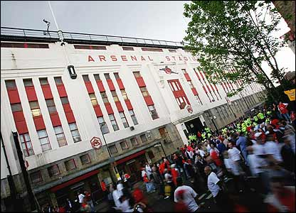 Fans leave Highbury stadium for the final time