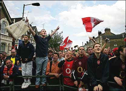 Arsenal fans celebrate outside the ground