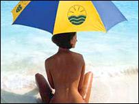 A nudist sitting on a beach