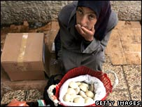 Woman selling bread in Bethlehem