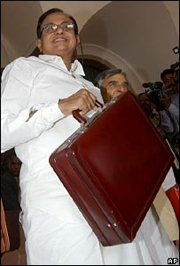 Indian Finance Minister Palaniappan Chidambaram smiles before entering the Parliament to present the Union budget for 2006-2007, in New Delhi, India