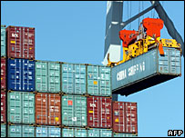 Containers moved by crane at container dock
