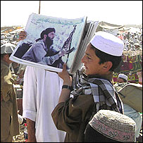 Boy selling posters of Gulbuddin Hekmatyar