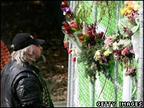 A man looks at flowers on the mine gate on Monday
