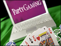 Partygaming, laptop and cards