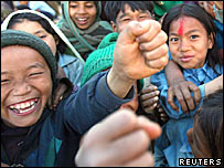 Nepalese children give the Maoist salute in Rolpa district