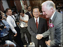 Craig Barrett, chairman of Intel Corporation, right is welcomed on stage by Vietnam's Deputy Prime Minister Nguyen Tan Dung during a license award ceremony at the Presidential Palace in Ho Chi Minh