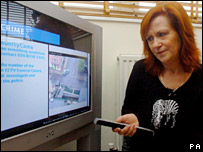 Jan Ashby watches CCTV on her own television